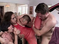 Hot brunette babe fucks four lucky guys on a couch