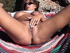 Hottie using her dildo outdoors