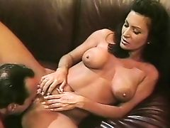Sexy mature brunette sucks cock and gets fucked on the sofa