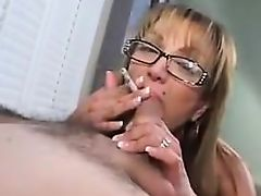 Mature chick smoking