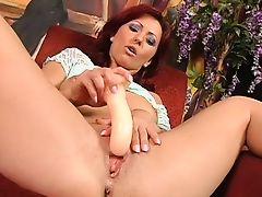 Redhead uses a dildo