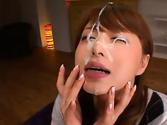 japanese brunette gets a nice sticky load on her face