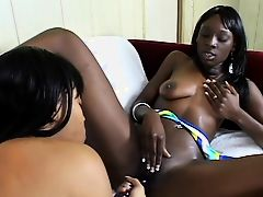 Two flexible black lesbians with leather boots lick pussy and fuck with toys