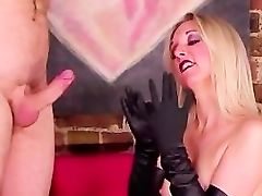 Domina rubs herself while sucking cock