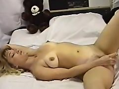 older woman masturbates