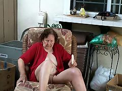 Granny Fucking Vibrator on Lounge In Patio