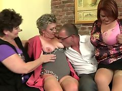Mature mothers sharing one lucky boy's cock