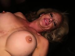 Round boobed Milf getting fucked by a  stranger gangbang